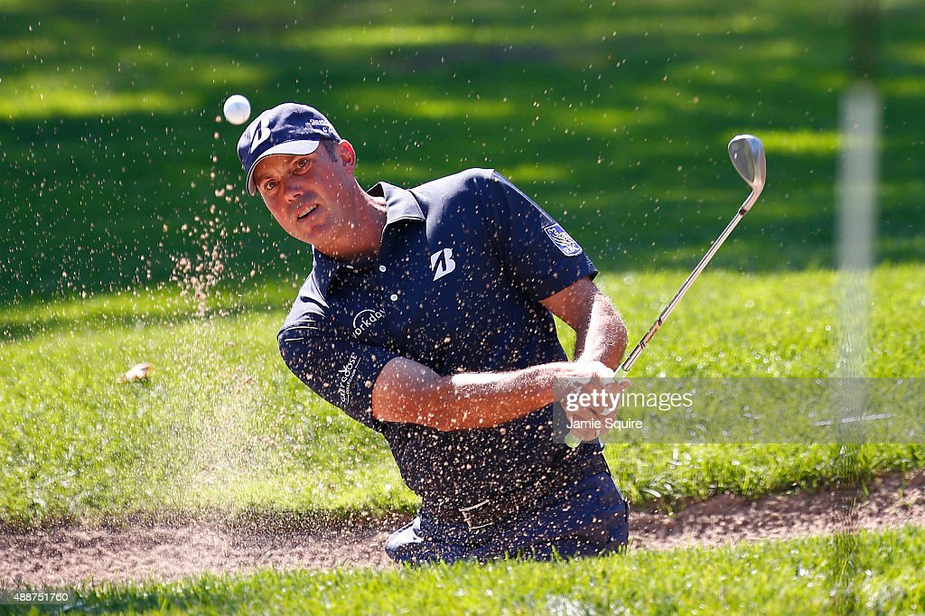 Matt Kuchar plays a shot from a bunker on the first hole during the First Round of the BMW Championship at Conway Farms Golf Club on September 17, 2015 in Lake Forest, Illinois.