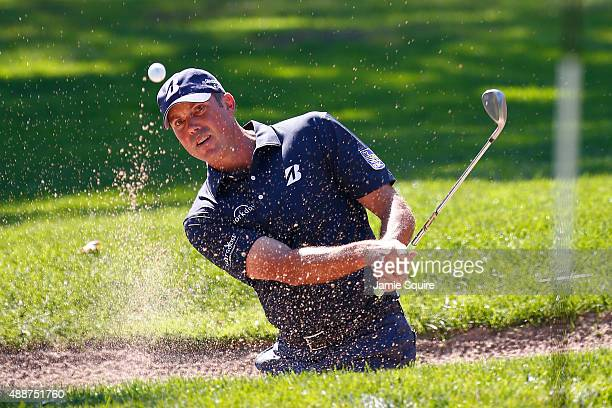 Matt Kuchar plays a shot from a bunker on the first hole during the First Round of the BMW Championship at Conway Farms Golf Club on September 17...