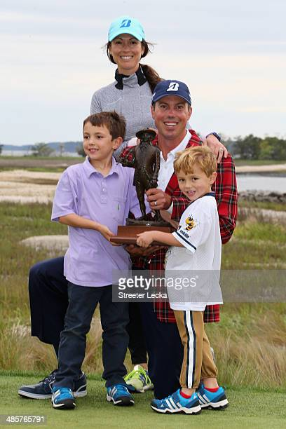 Matt Kuchar poses with his trophy and with his wife Sybi and sons Carson and Cameron on the 18th green after winning the RBC Heritage at Harbour Town...