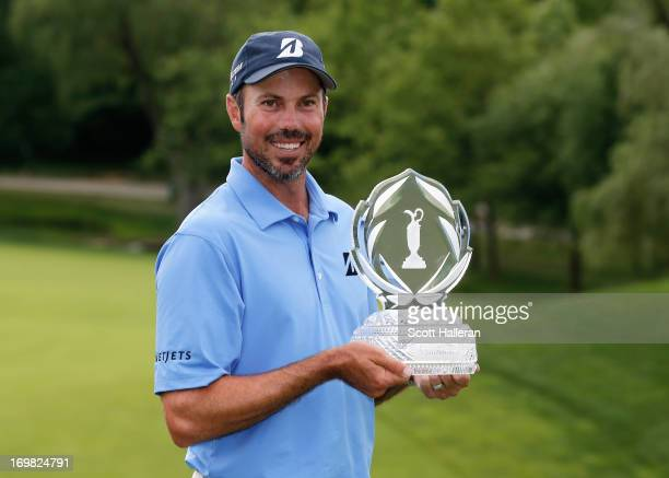Matt Kuchar poses with the trophy after his twostroke victory at the Memorial Tournament presented by Nationwide Insurance at Muirfield Village Golf...