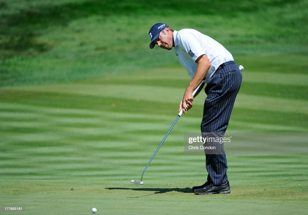 <a gi-track='captionPersonalityLinkClicked' href=/galleries/search?phrase=Matt+Kuchar&family=editorial&specificpeople=243226 ng-click='$event.stopPropagation()'>Matt Kuchar</a> putts for par on the first hole green during the final round of The Barclays at Liberty National Golf Club on August 25, 2013 in Jersey City, New Jersey.
