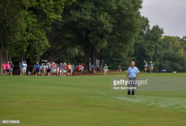 Matt Kuchar stands alone in the 10th hole fairway looking for the best approach after landing his drive in the rough during the second round of the...