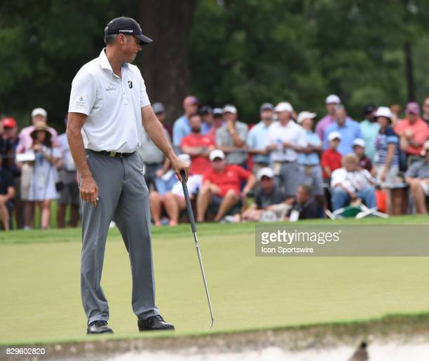 Matt Kuchar stares at the hole in disbelief after missing a short putt during the first round of the PGA Championship on August 10 2017 at Quail...