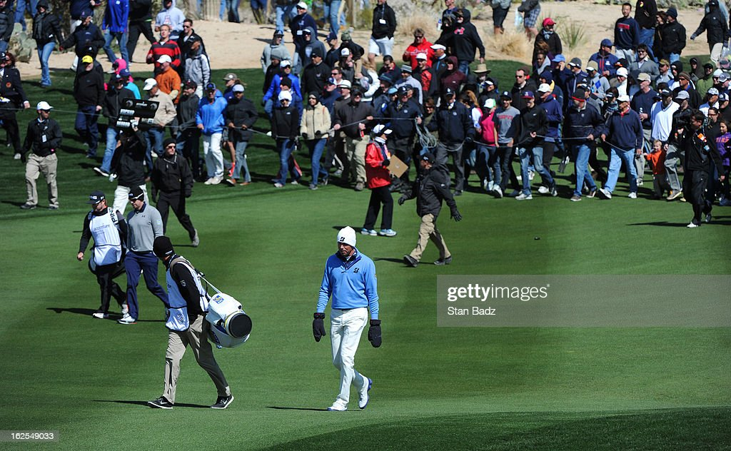 Matt Kuchar walks down the second fairway with the gallery following during the final round of the World Golf Championships-Accenture Match Play Championship at The Golf Club at Dove Mountain on February 24, 2013 in Marana, Arizona.