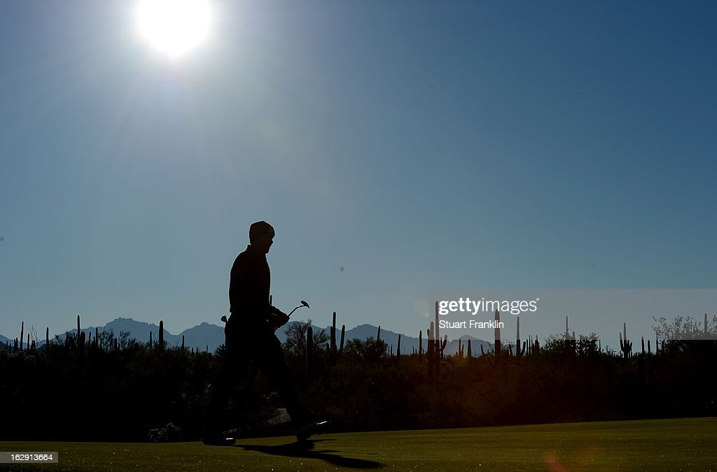 <a gi-track='captionPersonalityLinkClicked' href=/galleries/search?phrase=Matt+Kuchar&family=editorial&specificpeople=243226 ng-click='$event.stopPropagation()'>Matt Kuchar</a> walks on the first hole fairway during the third round of the World Golf Championships - Accenture Match Play at the Golf Club at Dove Mountain on February 23, 2013 in Marana, Arizona.