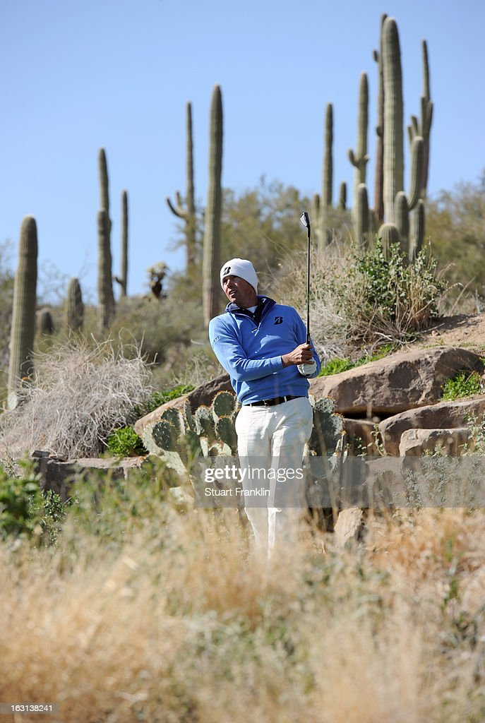 Matt Kuchar watches his shot during the final round of the World Golf Championships - Accenture Match Play at the Golf Club at Dove Mountain on February 24, 2013 in Marana, Arizona.