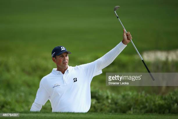 Matt Kuchar watches his shot on the 18th green during the final round of the RBC Heritage at Harbour Town Golf Links on April 20 2014 in Hilton Head...