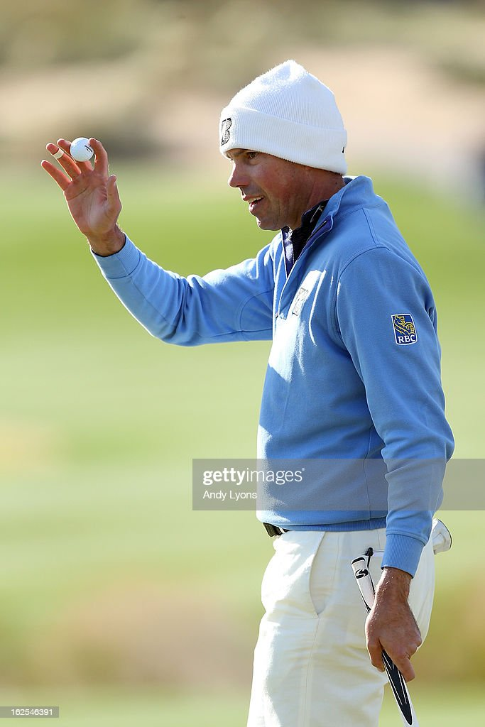 Matt Kuchar waves his ball to the gallery after he made a putt on the 15th hole during the final round of the World Golf Championships - Accenture Match Play at the Golf Club at Dove Mountain on February 24, 2013 in Marana, Arizona.