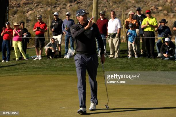 Matt Kuchar waves his ball to the gallery as he celebrates after he made a birdie putt to win the hole on the 15th hole green during the quarterfinal...