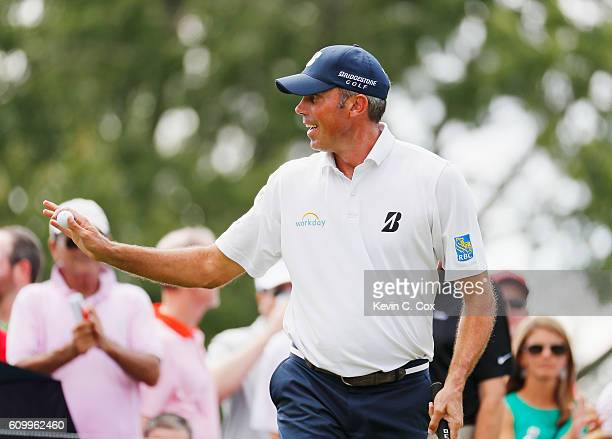 Matt Kuchar waves to the gallery after a birdie on the first hole during the second round of the TOUR Championship at East Lake Golf Club on...