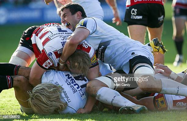 Matt Kvesic of Gloucester holds onto Tom Biggs of Worcester Warriors during the Aviva Premiership match between Gloucester Rugby and Worcester...
