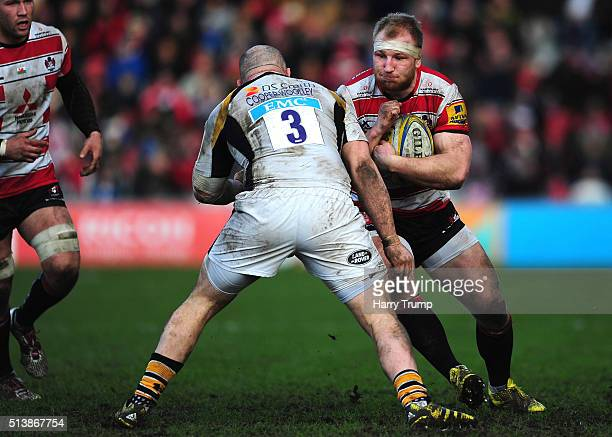 Matt Kvesic of Gloucester is tackled by Jake CooperWoolley of Wasps during the Aviva Premiership match between Gloucester Rugby and Wasps at...