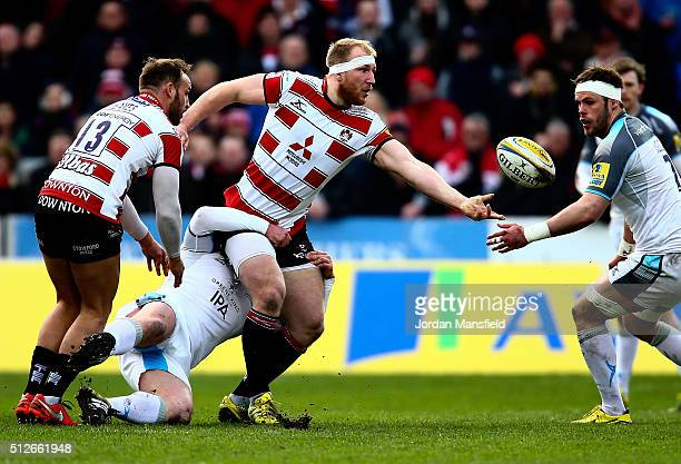 Matt Kvesic of Gloucester passes the ball after being tackled by Will Welch of Newcastle during the Aviva Premiership match between Gloucester Rugby...