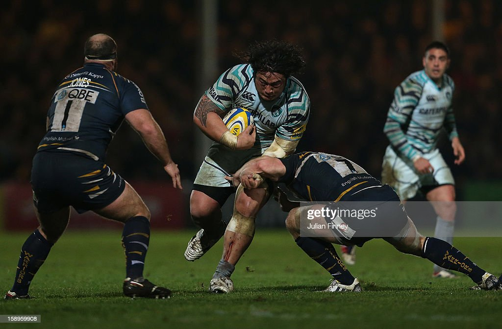 Matt Kvesic of Worcester tackles Logovi'i Mulipola of Leicester Tigers during the Aviva Premiership match between Worcester Warriors and Leicester Tigers at Sixways Stadium on January 4, 2013 in Worcester, England.