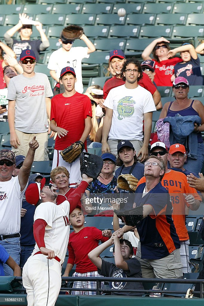 Matt LaPorta of the Cleveland Indians goes after a foul ball in the stands against the Detroit Tigers during their game on September 16 2012 at...