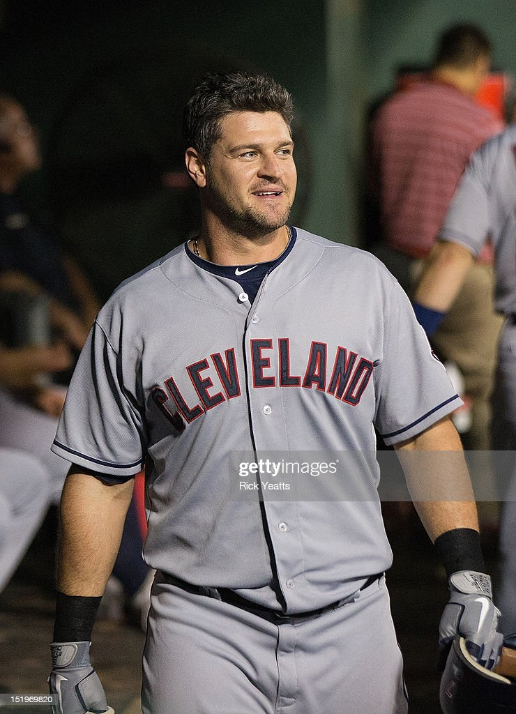 Matt LaPorta of the Cleveland Indians in the dugout after hitting a home run in the sixth inning to tie the game against the Texas Rangers at Rangers...