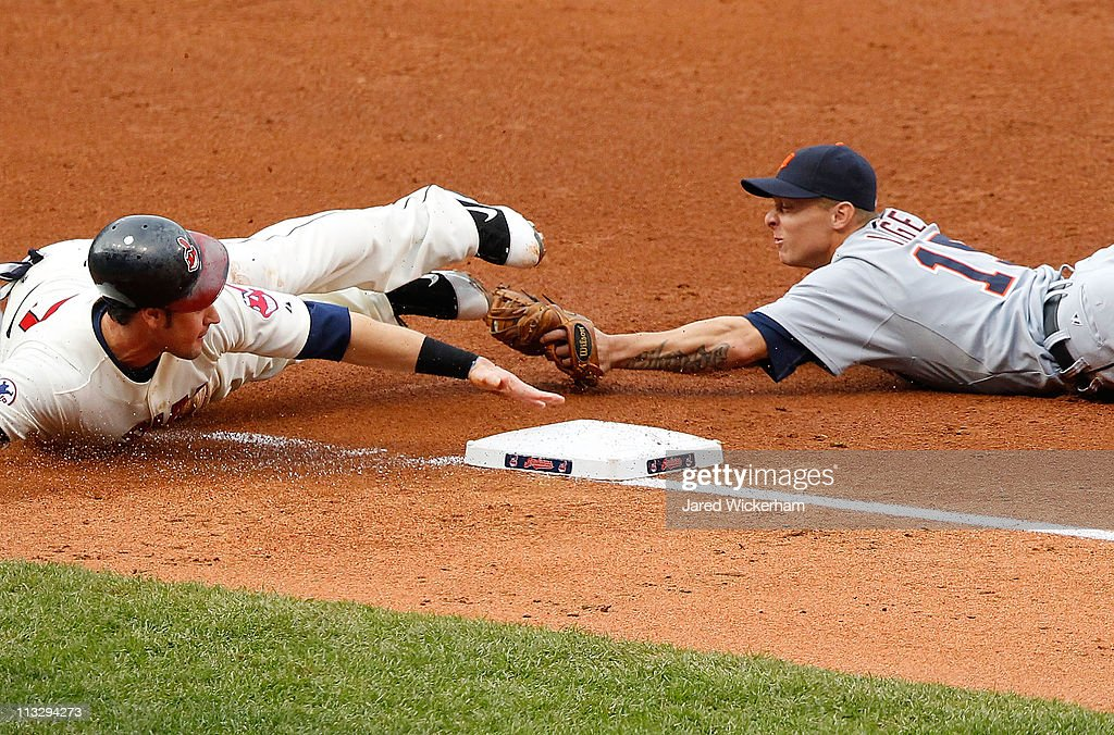 Matt LaPorta of the Cleveland Indians is tagged out at third base by Brandon Inge of the Detroit Tigers during the game on April 30 2011 at...