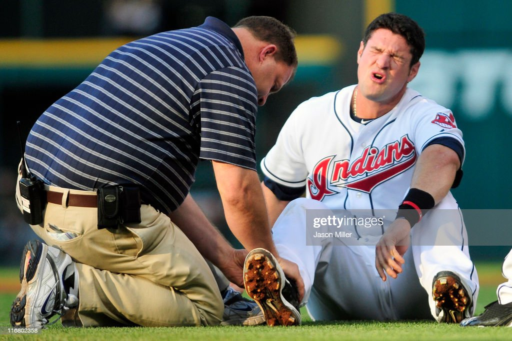 <a gi-track='captionPersonalityLinkClicked' href=/galleries/search?phrase=Matt+LaPorta&family=editorial&specificpeople=2315200 ng-click='$event.stopPropagation()'>Matt LaPorta</a> #7 of the Cleveland Indians reacts to an injury after being caught in a rundown between second and third base during the third inning against the Pittsburgh Pirates at Progressive Field on June 17, 2011 in Cleveland, Ohio.