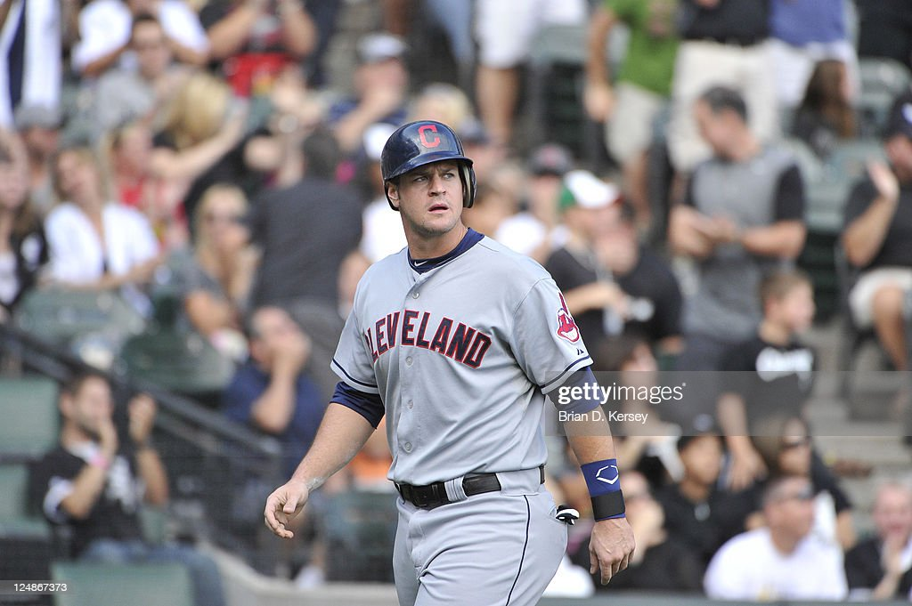 Matt LaPorta of the Cleveland Indians walks back to the dugout after being thrown out at home plate against the Chicago White Sox at US Cellular...