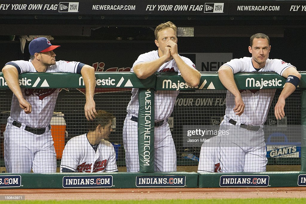 Matt LaPorta Shelley Duncan and Jack Hannahan of the Cleveland Indians watch the game from the dugout during the ninth inning against the against the...