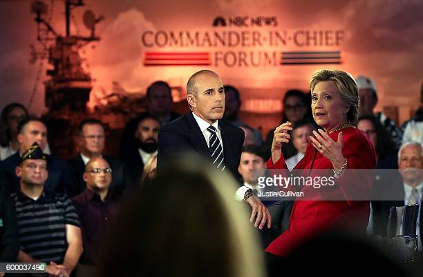 Matt Lauer looks on as Democratic presidential nominee Hillary Clinton speaks during the NBC News CommanderinChief Forum on September 7 2016 in New...