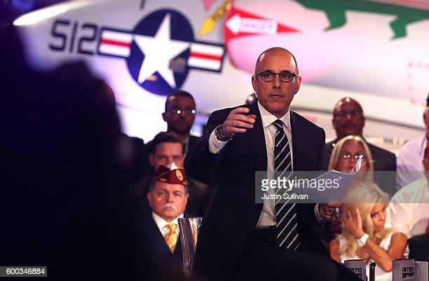 Matt Lauer looks on during the NBC News CommanderinChief Forum with democratic presidential nominee former Secretary of State Hillary Clinton on...