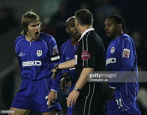 Matt Lawrence Barry Hayles and Andy Impey of Millwall argue with referee Clive Penton after he disallowed Coventry's goal and then allowed it during...