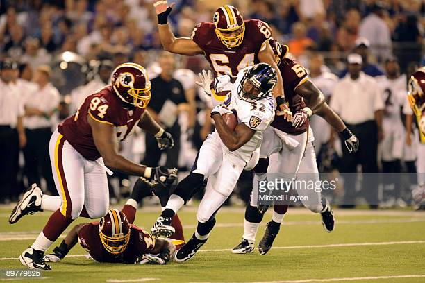 Matt Lawrence of the Baltimore Ravens runs with the ball during a NFL preseason football game against the Washington Redskins on August 13 2009 at M...