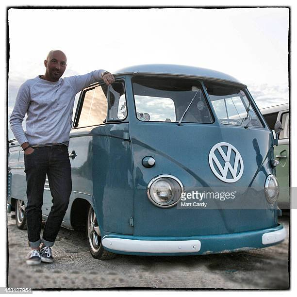 Matt Lawton from Stoke on Trent poses for a photograph besides his 1959 first generation or T1 splitscreen Volkswagen Transporter pickup van in...