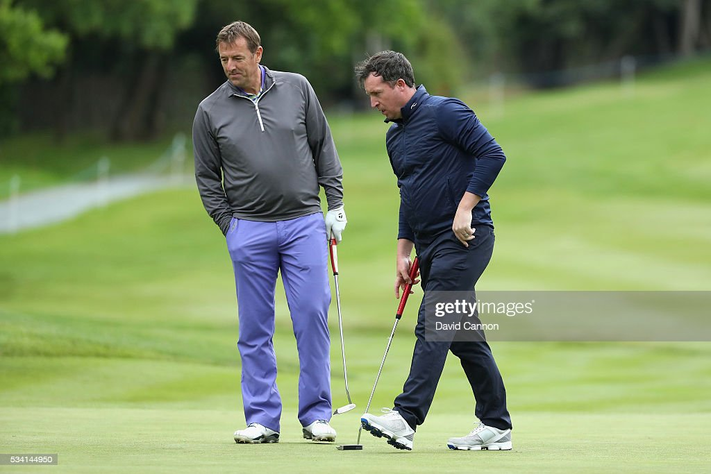 Matt Le Tissier and <a gi-track='captionPersonalityLinkClicked' href=/galleries/search?phrase=Robbie+Fowler&family=editorial&specificpeople=206154 ng-click='$event.stopPropagation()'>Robbie Fowler</a> look on during the Pro-Am prior to the BMW PGA Championship at Wentworth on May 25, 2016 in Virginia Water, England.
