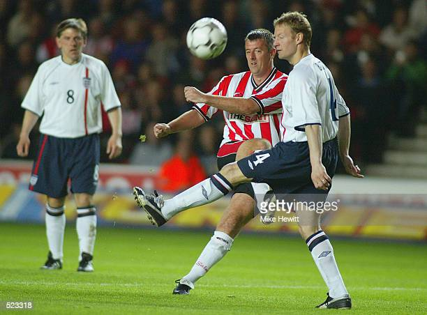 Matt Le Tissier of Southampton shoots at goal under pressure from David Batty of England XI during the Matt Le Tissier Testimonial match played...