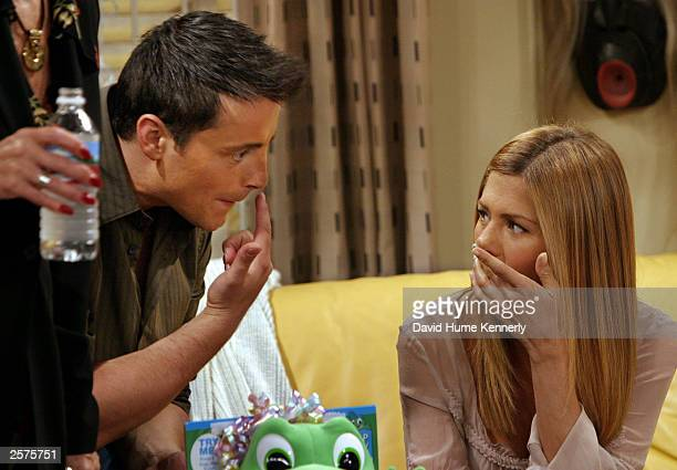 Matt LeBlanc points out a makeup flaw to costar Jennifer Aniston on the set of the hit NBC series 'Friends' during filming of one of their last shows...