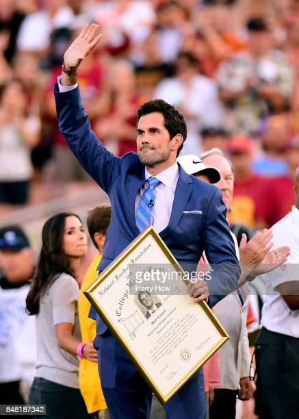 Matt Leinart waves to fans in reaction to his induction into the College Football Hall of Fame during a break in the game between the Texas Longhorns...