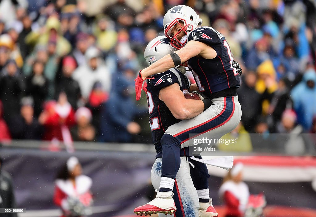 Matt Lengel #82 of the New England Patriots reacts with Julian Edelman #11 after catching a touchdown pass during the second quarter of a game against the New York Jets at Gillette Stadium on December 24, 2016 in Foxboro, Massachusetts.