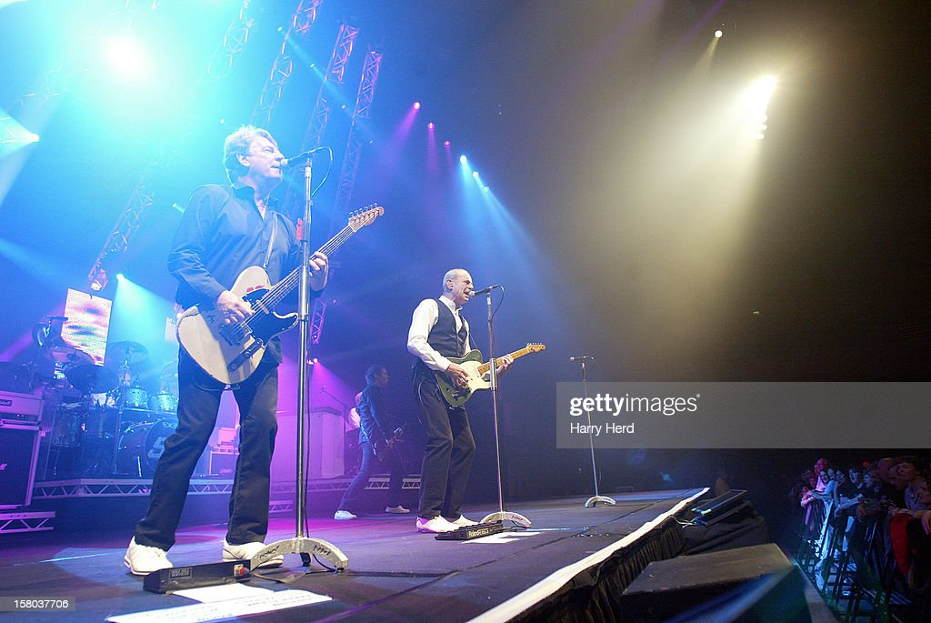 Matt Letley, Rick Parfitt, Francis Rossi and John Edwards of Status Quo perform at Quofestive at the BIC on December 9, 2012 in Bournemouth, England.