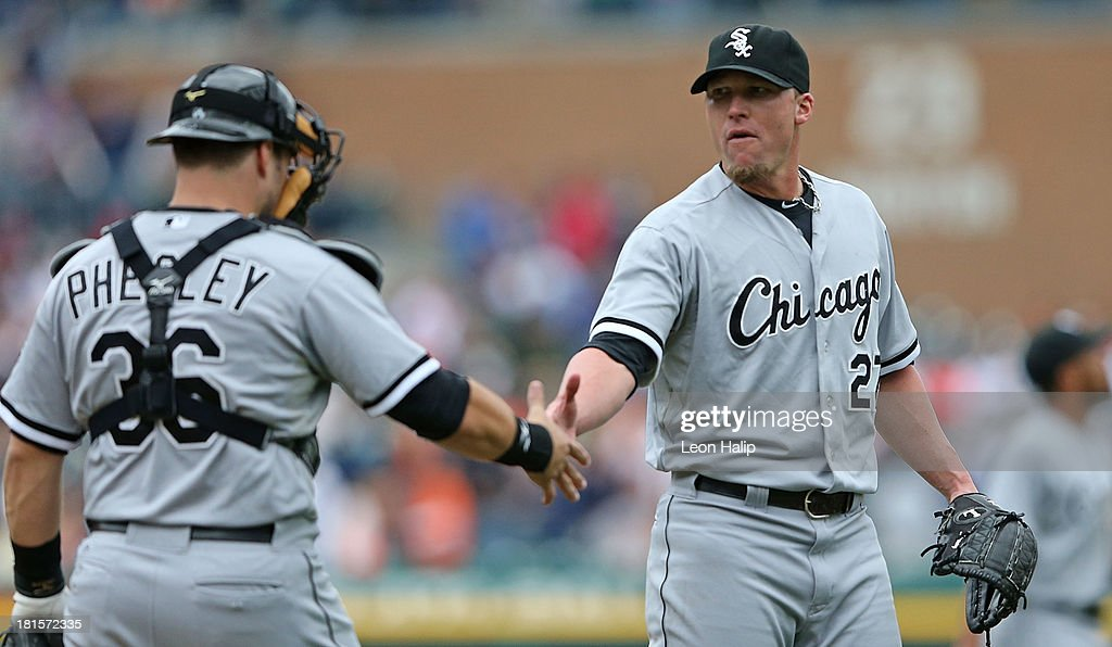 <a gi-track='captionPersonalityLinkClicked' href=/galleries/search?phrase=Matt+Lindstrom&family=editorial&specificpeople=757505 ng-click='$event.stopPropagation()'>Matt Lindstrom</a> #27 of the Chicago White Sox celebrates a win over the Detroit Tigers with catcher Josh Phegley #36 at Comerica Park on September 22, 2013 in Detroit, Michigan. The White Sox defeated the Tigers 6-3.