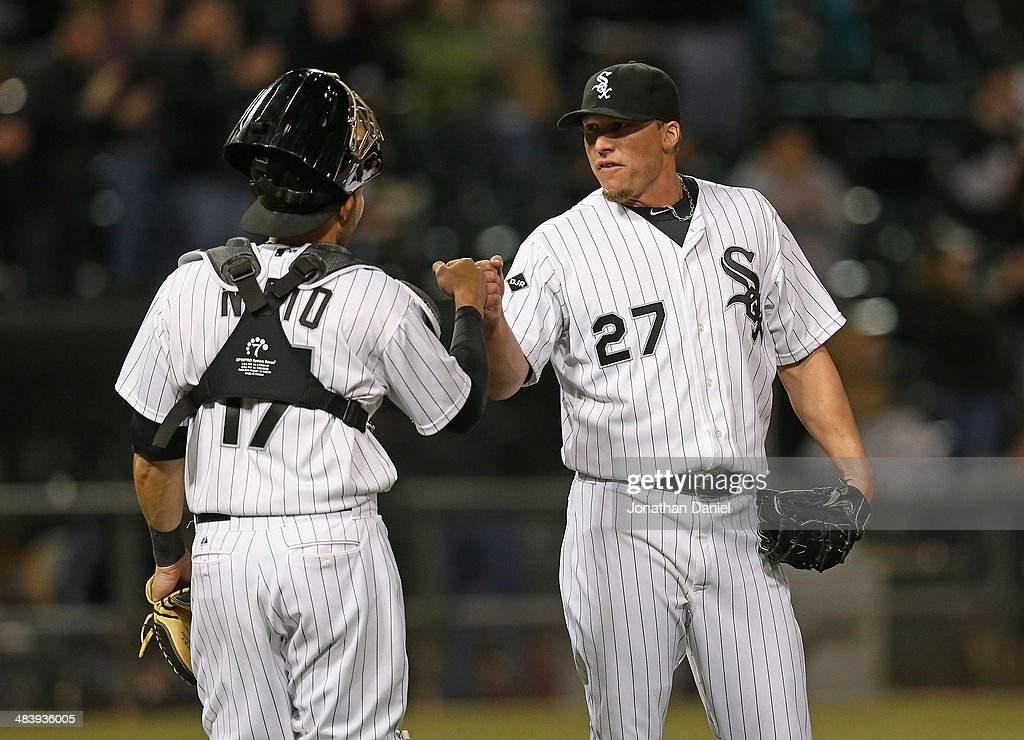 <a gi-track='captionPersonalityLinkClicked' href=/galleries/search?phrase=Matt+Lindstrom&family=editorial&specificpeople=757505 ng-click='$event.stopPropagation()'>Matt Lindstrom</a> #27 of the Chicago White Sox celebrates a win with Adrian Nieto #17 over the Cleveland Indians at U.S. Cellular Field on April 10, 2014 in Chicago, Illinois. The White Sox defeated the Indians 7-3.