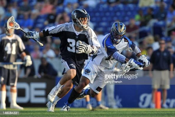 Matt Mackrides of the Chesapeake Bayhawks moves the ball against the Charlotte Hounds at NavyMarine Corps Memorial Stadium on June 9 2012 in...