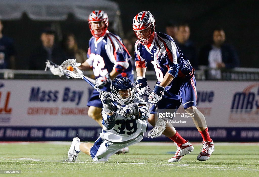 Matt Mackrides #39 of the Chesapeake Baykawks passes the ball while falling to the ground against the Boston Cannons in the second half during the game on May 18, 2013 at Harvard Stadium in Boston, Massachusetts.