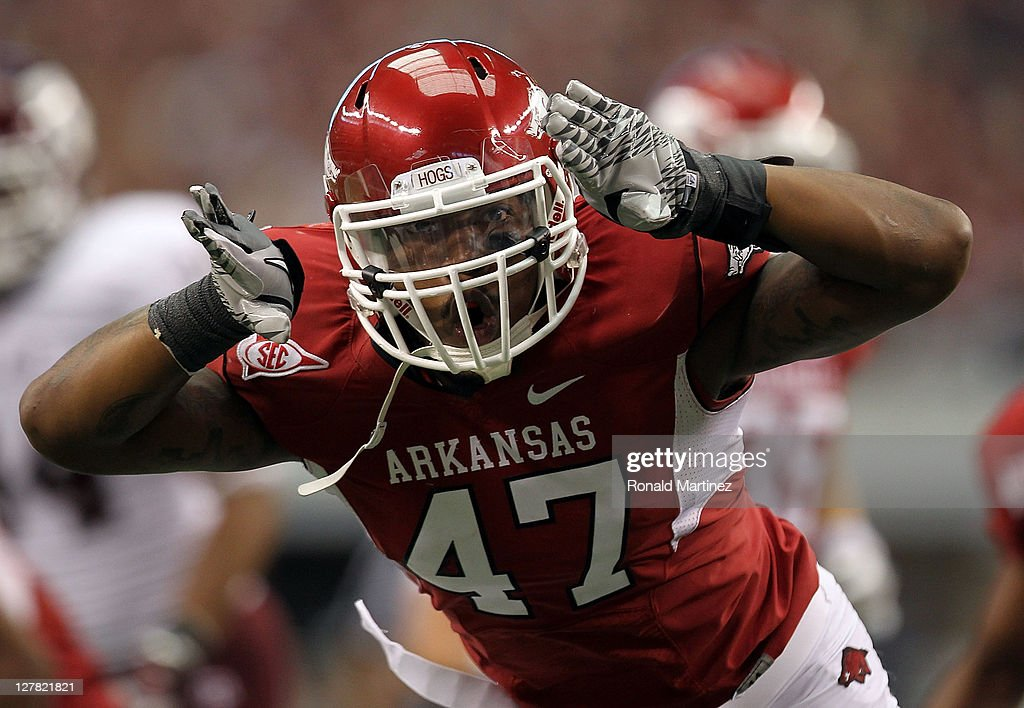 Matt Marshall #47 of the Arkansas Razorbacks celebrates a tackle against the Texas A&M Aggies at Cowboys Stadium on October 1, 2011 in Arlington, Texas.