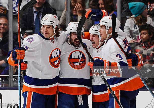 Matt Martin Cal Clutterbuck Casey Cizikas and Travis Hamonic of the New York Islanders celebrate a third period goal during NHL game action against...