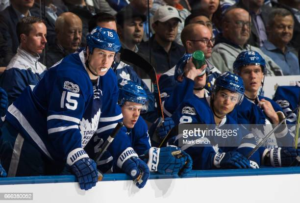 Matt Martin Kasperi Kapanen Connor Carrick and Nikita Zaitsev of the Toronto Maple Leafs looks on from the bench as they play the Tampa Bay Lightning...