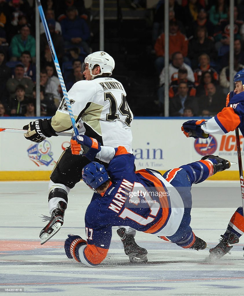 Matt Martin #17 of the New York Islanders bounces off Chris Kunitz #14 of the Pittsburgh Penguins at Nassau Veterans Memorial Coliseum on March 22, 2013 in Uniondale, New York. The Penguins defeated the Islanders 4-2.