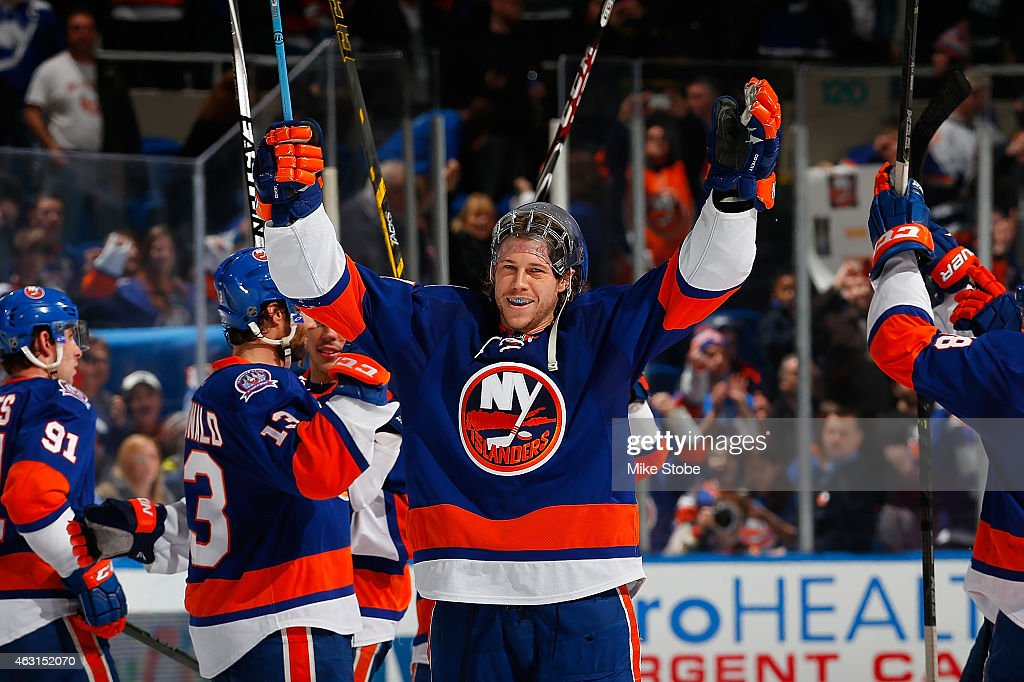 Matt Martin #17 of the New York Islanders celebrates after the New York Islanders defeated the Edmonton Oilers at Nassau Veterans Memorial Coliseum on February 10, 2015 in Uniondale, New York. The New York Islanders defeated the Edmonton Oilers 3-2.