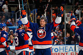Matt Martin of the New York Islanders celebrates after the New York Islanders defeated the Edmonton Oilers at Nassau Veterans Memorial Coliseum on...