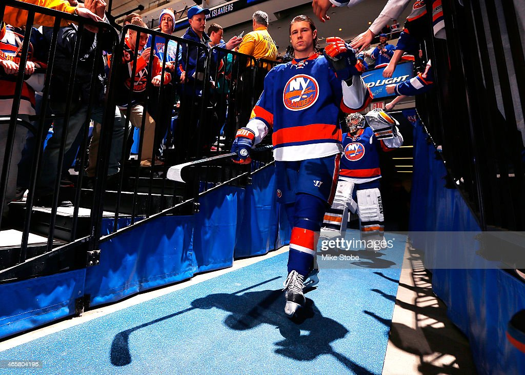 Matt Martin of the New York Islanders comes walks out onto the ice for warmups prior to a game against the New York Rangers at Nassau Veterans...
