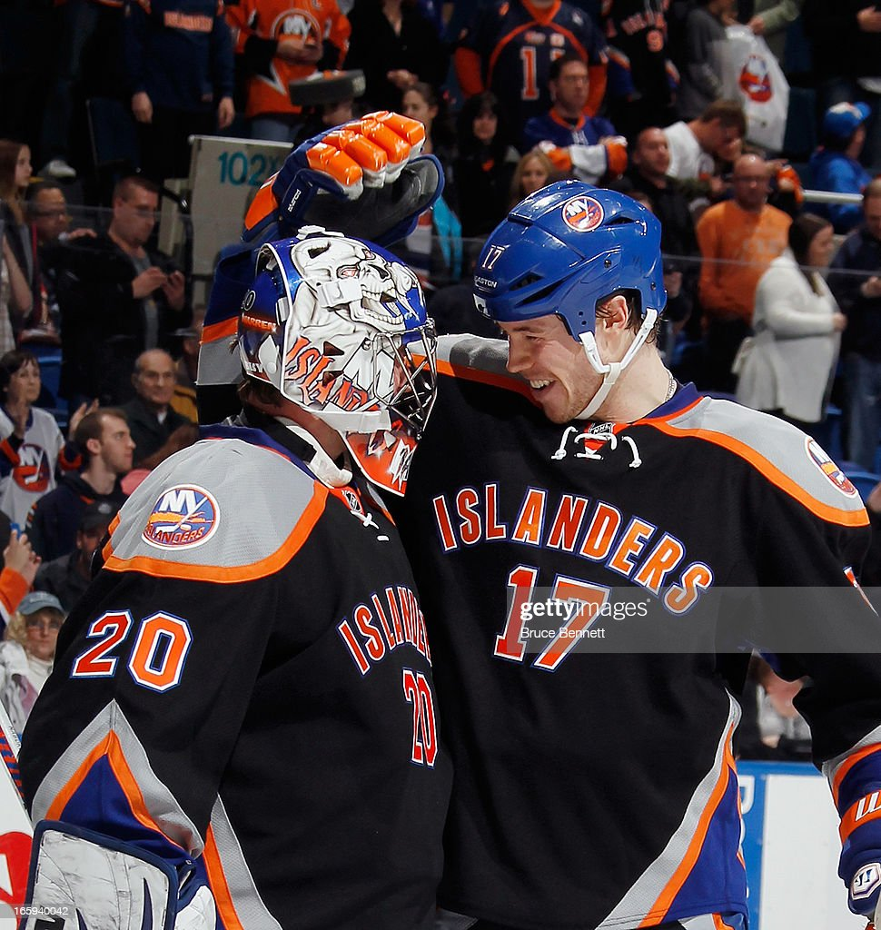 Matt Martin #17 of the New York Islanders congratulates <a gi-track='captionPersonalityLinkClicked' href=/galleries/search?phrase=Evgeni+Nabokov&family=editorial&specificpeople=171380 ng-click='$event.stopPropagation()'>Evgeni Nabokov</a> #20 on their victory over the Tampa Bay Lightning at the Nassau Veterans Memorial Coliseum on April 6, 2013 in Uniondale, New York. The Islanders defeated the Lightning 4-2.