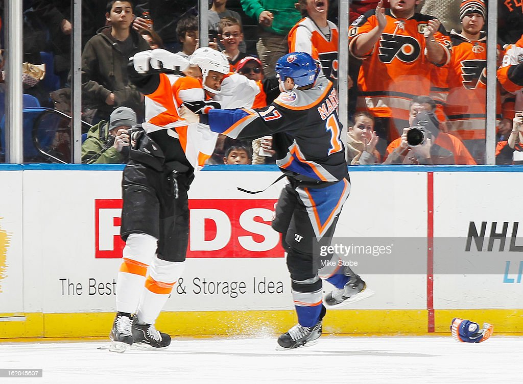 Matt Martin #17 of the New York Islanders gets tangled up with <a gi-track='captionPersonalityLinkClicked' href=/galleries/search?phrase=Wayne+Simmonds&family=editorial&specificpeople=4212617 ng-click='$event.stopPropagation()'>Wayne Simmonds</a> #17 of the Philadelphia Flyers at Nassau Veterans Memorial Coliseum on February 18, 2013 in Uniondale, New York. The Islanders were shut out by the Flyers 7-0.