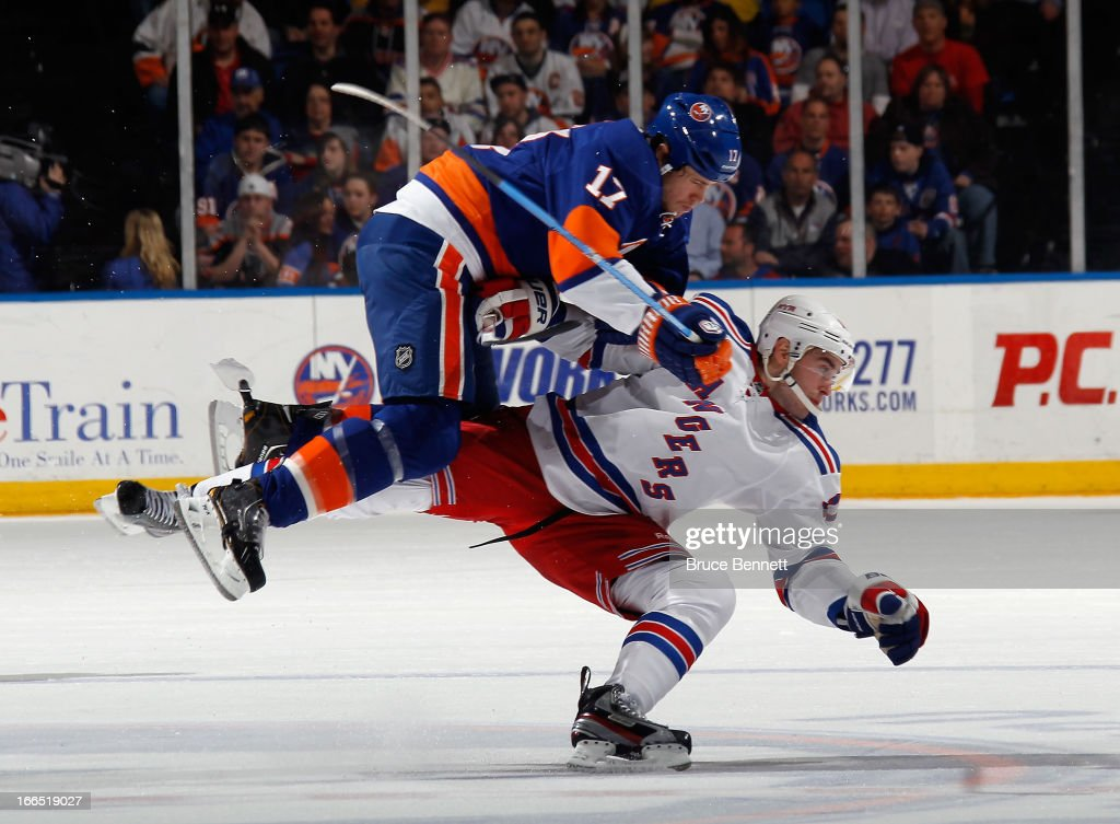 Matt Martin #17 of the New York Islanders hits <a gi-track='captionPersonalityLinkClicked' href=/galleries/search?phrase=John+Moore+-+Ice+Hockey+Player&family=editorial&specificpeople=5948842 ng-click='$event.stopPropagation()'>John Moore</a> #17 of the New York Rangers during the first period at the Nassau Veterans Memorial Coliseum on April 13, 2013 in Uniondale, New York.