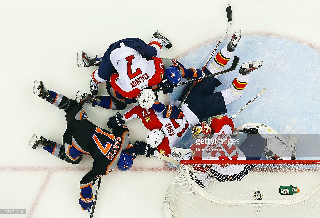 Matt Martin #17 of the New York Islanders is stopped by the Florida Panthers at the Nassau Veterans Memorial Coliseum on March 24, 2013 in Uniondale, New York. The Islanders defeated the Panthers 3-0.